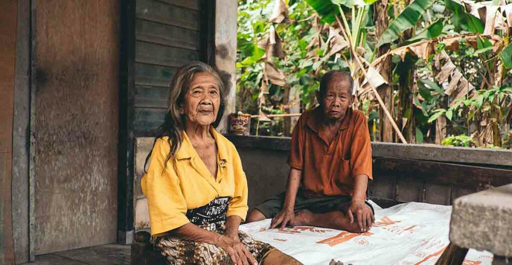 Elderly female and male sitting who need language access services under Section 1557 of the ACA