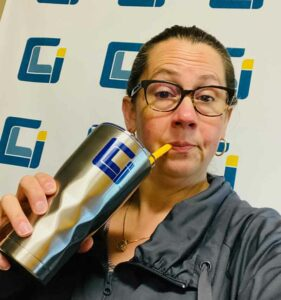 CLI's director of HR takes a selfie while sipping on a coffee through a straw