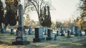 Several aboveground tombstones in a cemetery
