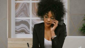 Woman on a cellphone call a telephone interpreting service.
