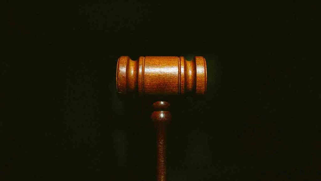 Close up of  brown gavel on a black background.