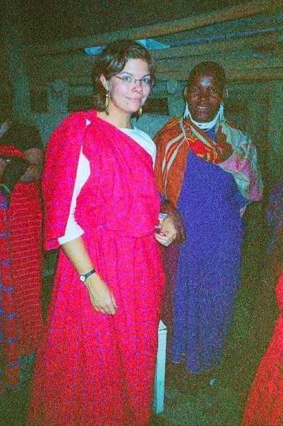 Brie standing next to a Maasai tribal member.