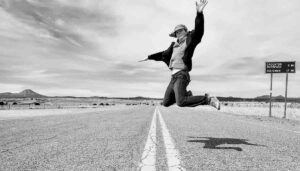 Brie jumps in the middle of a road while on vacation to White Sands National Park in New Mexico.